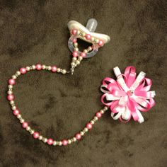 I made Beaded pacifier clips! For special occasions and photo day - only use under direct supervision of an adult! While they are double strung on bead wire they are small beads....