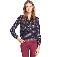 Tommy Hilfiger women's top. It doesn't any get lovelier than this. Our trimly tailored blouse in foulard with a lush bow front and center. In fabric that feels like real silk (with none of the maintenance). • Classic fit.• 100% synthetic. • Tie-collar, button cuffs. • Machine washable. • Imported.