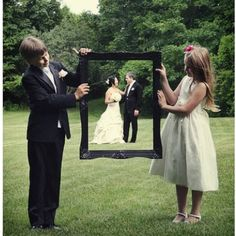 Wedding pictures- parents holding frame rather than kids :)