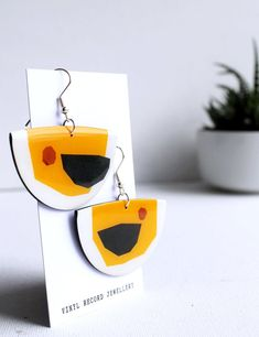 Quirky one of a kind sustainable recycled vinyl record earrings by Dana Jewellery. Ethical fashion / handmade in Ireland Eco Resin, Recycled Jewelry, Handmade Accessories, Ethical Fashion, Signature Style, Sustainable Fashion, Vinyl Records, Earrings Handmade, Sustainability