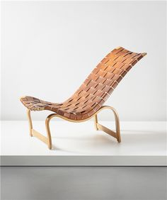 BRUNO MATHSSON Lounge chair, designed 1936, executed 1939  Laminated birch plywood, birch, leather. 80.5 x 50.7 x 100 cm (31 3/4 x 19 7/8 x 39 3/8 in) Manufactured by Firma Karl Mathsson, Sweden. Underside of frame with two manufacturer's paper labels 'Komp. 1936/Bruno Mathsson/Tillv. 39/Karl Mathsson/Varnamo' and 'MADE IN SWEDEN'.