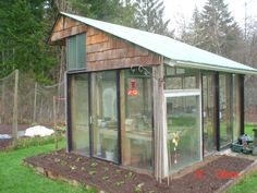Recycled greenhouse with slanted roof