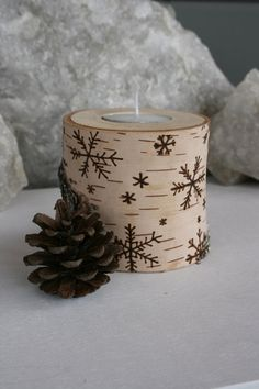 This is a unique tealight candle holder with snowflakes burnt into the bark... a process known as pyrography or commonly referred to as woodburning! I dont use stamps or patterns so just like real snowflakes...each one is different! These birch rounds are also very unique and the moss and lichens you see on them grew that way!  A perfect addition to your centerpiece for Christmas surrounded with a few pine cones to finish it off! Simple and beautiful!  I am honoured to have had my snowflake…