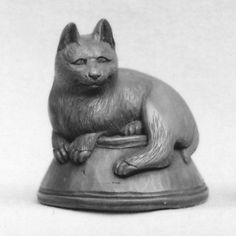 Netsuke of Cat Lying on a Bowl, underneath which is a Fish -- small wood carving, 19th century Japan
