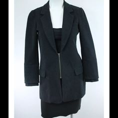 "Dark Gray Rayon Nylon Jacket Blazer Excellent like new condition; No Flaws  Details: Size 6  Zipper at front pockets at sides  Ribbed cuffs  Shell: 56% Rayon/38% Nylon/6% Polyurethane Combo: 100% Cotton Vest: 100% Cotton   Measurements Length: 27"" Sleeve length: 21.5"" Width between shoulders: 14"" Elizabeth and James Jackets & Coats Blazers"