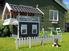 DIY dog houses- in my wildest dreams would my husband build this ;)