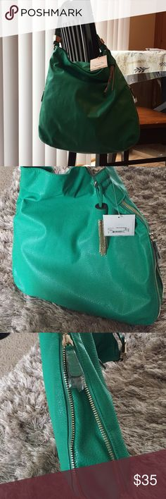 Beautiful green purse with side zipper detail Gorgeous green purse with gold zipper detail on sides NWT complete with plastic covers on zipper tags small spot of damage as shown in picture unnoticeable  feel free to make offer 😍🎉 brand is Cosmopolitan purchased from Charming Charlie Charming Charlie Bags
