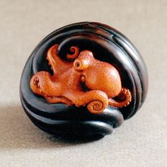 the shallows; netsuke - boxwood - 3.6cm