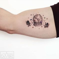 bicep tiny astronauts tattoo