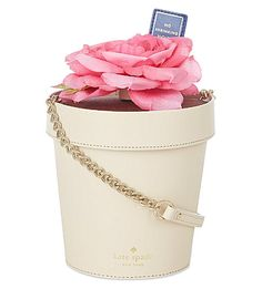 Kate Spade Spring Forward Flowerpot Bag. Genuine: approx $300. Dupe: $21.57. Check out my blog for the link to the dupe and tips on how to navigate AliExpress.