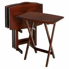"""Serve gourmet hors d'oeuvres before dinner or enjoy a snack and a movie with this beautiful tray, showcasing a foldable design and walnut finish.    Product: Four tray tables and standConstruction Material: WoodColor: WalnutFeatures: Foldable traysDimensions: 25.5"""" H x 23.6"""" W x 15.75"""" D each (tray)"""