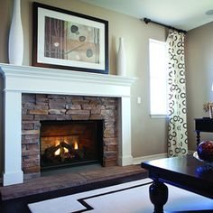 I like the simplicity of the mantle and I like the stone look, seems like it won't date the way tile might.