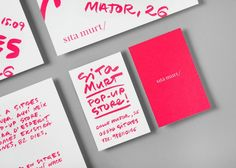 tiny white text on pink, reverse to bold pink text on white. business cards.