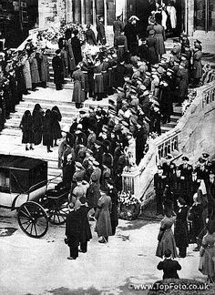 Guardsmen bear the Royal coffin of King George VI into St George's Chapel, Windsor, followed by the Queen, the Queen Mother, Princess Margaret and the Princess Royal in deep mourning. February 1952