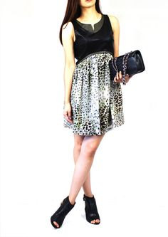 Ladies need a sleeveless dress no matter the temperature. This Naomi leopard print dress features a mix of black and olive faux leather accents on top that blends in perfectly with the playful leopard print drape. You can also match the dress with our Katy Faux Leather Jacket & Alice Quilted Double-Chain Bag and complete the street chic look!