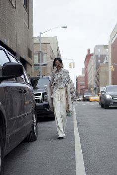 Song of Style. Striped ruffle blouse+ivory wide-leg pants+black shoes+natural and taupe fur coat+green chain shoulder bag+sunglasses. Winter Fashion Week Event Outfit 2017