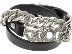 ANASTASIA BLACK LEATHER AND CHAIN BRACELET  The Anastasia brings glam punk to your look featuring a wrap-around cuff of black leather, silver-plated Cuban chain, and crystal-laden link. The edgy little bit of something for your twilight rendezvous.