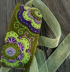 bracelet.... <3 <3 <3 Always love purple and green...great asymetrical design