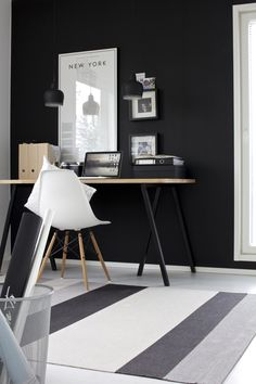 Home office with a black wall via the blog Lisbet E.