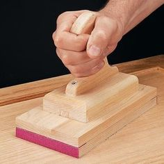 An oversized sanding block is handy to have around the shop. This simple design gives you a sanding block employs a half sheet of sandpaper that lets you cover large areas quickly. Woodworking Jigs, Woodworking Projects, Block Plan, Carpentry Skills, Sanding Block, Sandpaper, Diy Tools, Simple Designs, Diy Design