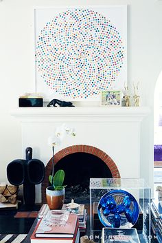 Damien Hirst painting, Jeff Koons sculpture, brick and white fireplaces // living rooms