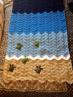 My first blanket made for a sweet little baby due June 2015!  The nursery theme is under the sea, and Dad likes turtles.