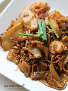 Char Kway Teow One of the many traditional dishes you should find at a Cooking Class from Viator. Find out more at: http://www.shareasale.com/r.cfm?u=902724&b=132440&m=18208&afftrack=&urllink=www%2Eviator%2Ecom%2FSingapore%2Dtours%2FCooking%2DClasses%2Fd18%2Dg6%2Dc19 #Singapore Travel #Singapore Food #Singapore Cooking Classes