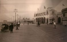 Underhill on the boardwalk: the photographer captures a seemingly meloncholy day in Coney Island, with Childs Restaurant at right