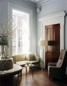 The floor, the door with painted frame, the couch, the molding - what isn't to like about this room?