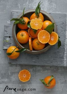 Love how refreshing the fruit looks with the leaves still attached. More than just giving me a thirst for freshly-squeezed orange juice, I like the artistic flair in this picture from the rustic grey board and the way it contrasts with the bright floral effect of the peeled orange in the bowl.