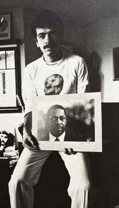 Carlos Santana holding a photograph of John Coltrane, c.1973.