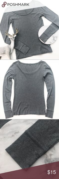 Mossimo Long Sleeve Cuffed Layering Tee Tshirt Mossimo long sleeve cuffed gray tee. Cozy and thicker fabric (a bit thicker than standard cheap T-shirts).  Gray. Great for winter layering. Size Small. Underarm to underarm: Length, shoulder seam to hem:  Inventory Y26 Mossimo Supply Co Tops Tees - Long Sleeve