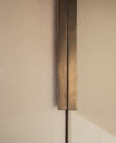 Echlin leather wardrobe door with bronze handle and inlay