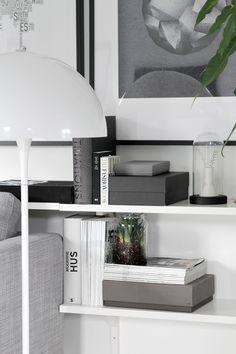bookshelf . grey and white . home decor . interior design inspiration . neutral colors . modern and stylish .