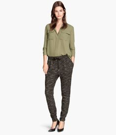 Jogging-style pants in sweatshirt fabric with an elasticized drawstring waistband, side pockets, and a mock back pocket.