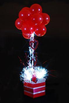 Sparkle Sparkle Sparkle!   Beautiful Red Qualatex balloon table topiary tree, with Sparkle Lites Fireworks and Sparkle Ribbon.   www.sparklelites.com