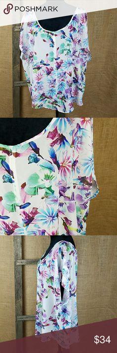 "Torrid women plus size 2X floral crossover back Torrid women plus size 2X floral crossover back chiffon sheer short sleeve shirt.  Under arm to under arm: 28.5"" Length: 22"" torrid Tops Blouses"