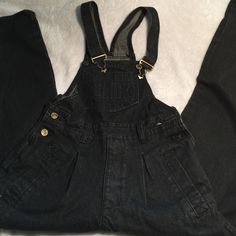 Vintage Dark denim Overalls soooo cool!!! found it on one of my vintage hunting. it fits a size 26 well I would say since that's the size I am a 26 or a 3 or lower. buttons at the sides of the waist. Not UO. I never wore it except for pictures but I washed it Urban Outfitters Pants Jumpsuits & Rompers