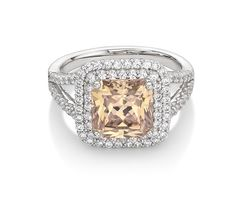 Monte Carlo Light Champagne Ring                                 Platinum on Silver Princess Cut Ring with Champagne and White Stones $230