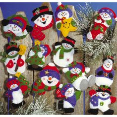 TOBIN-Felt Applique: Holiday Collection: Ornaments: set of 13. These fabulously festive kits by Tobin include everything you will need to add color; warmth and fun to your next holiday season. Design: Lots a Fun! Snowman.