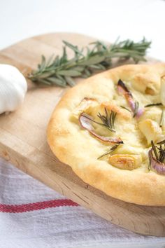 One bite of this Garlic Rosemary Pizza and you'll think you died and woke up in Italy's version of heaven.