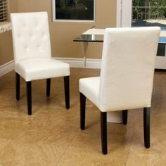 Costco: Angelo Bonded Leather Dining Chair 2-Pack. Six of these chairs would fit nicely with the glass dining room table I like the best.
