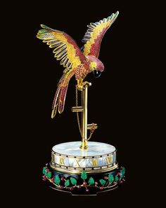 "CARTIER. A MAGNIFICENT, EXTREMELY FINE AND POSSIBLY UNIQUE 18K GOLD, DIAMOND, YELLOW DIAMOND, RUBY, EMERALD, SAPPHIRE, MOTHER-OF-PEARL AND ONYX-SET PENDULE À CERCLE TOURNANT MANTEL CLOCK SIGNED CARTIER, ""PARROT CLOCK"", CASE NO. WK900015, CIRCA 1991"