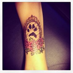 Frame and dog paw! Its my new tattoo. This is my puppys paw and best tattoo.