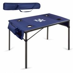 Kentucky Wildcats Travel Table - by Picnic Time. Short Description: Picnic Time's Travel Table is a portable, soft-top table for four that features six cup holders and two zippered security pockets to hold personal effects. The Travel Table comes equipped with matching drawstring carry bag. Made of 600D polyester with a powder-coated steel frame, this table is perfect for tailgating, camping, or card games.  Components:  1 Portable soft-top table, 1 Carry bag    Key Features…
