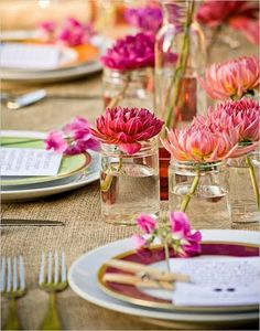 Love the jars as vases and bright single flowers!
