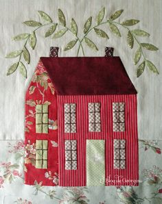 A very sweet house block. Would be very pretty in a sampler or block of the month type quilt.