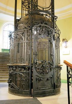 """Lift! Art Nouveau was considered a """"total style"""", which means that it includes a hierarchy of scales in design: architecture, interior design, decorative arts, including furniture, textiles, jewelery, household silver and other objects and lighting, as well as the range of visual arts. This great modern style was known to be employed the most in architecture, interior design, jewelry and glass design, posters, and illustration."""