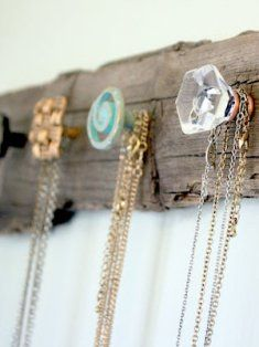 A great idea for knobs found at an antique store, some driftwood and jewelry is prettily stored! This would be cute as a coat rack!