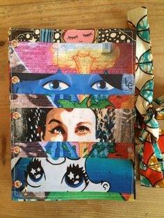 """Handmade notebook or journal with collage and fabric cover. For this notebook """"Cat eyes"""", i used my photographs from street art found on the walls of: -Barcelona, Spain -New York City, USA -Prague, Czech republic -Paris, France -Dublin, Ireland -Cabestany, France For sale on www.delphineiv.com"""